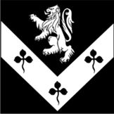Sable, on a chevron inverted argent three clovers sable, in chief a lion rampant argent. Passed January, 2014